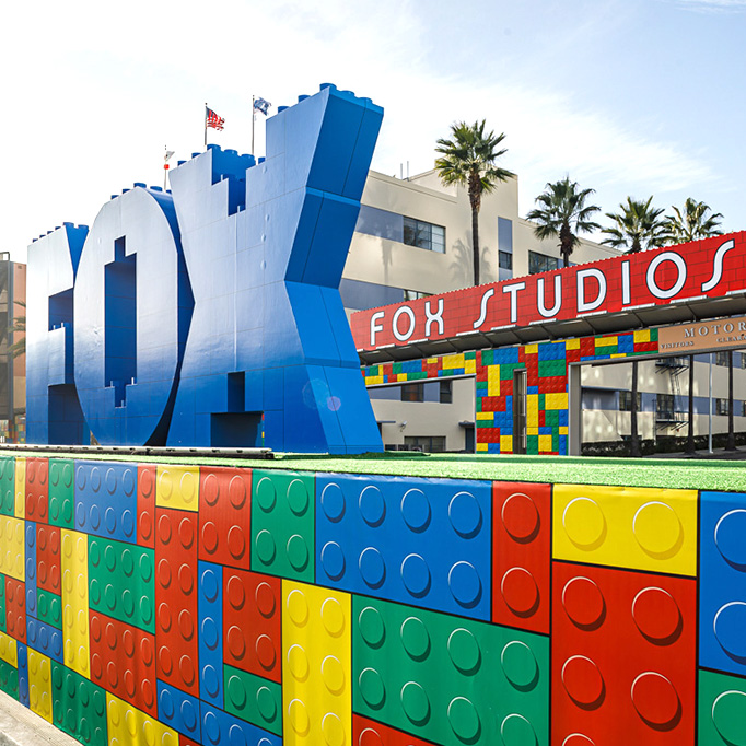 fox studios front gate decorated with lego-themed block wall set piece